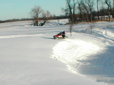 Snowmobile In Spring Creek During Winter