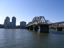 Both Bridges, View From Mid River
