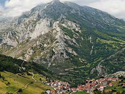 The Peaks Of The Central Massif Overlooking The Village Of Sotre