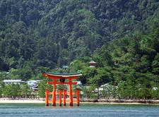 The Torii Of Itsukushima Shrine Rises