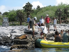 Tourist Group Landing At South Plaza Island In Galapagos Ecuador