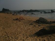 Tourist Sunbathing On Beach