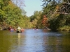 Tourists Canoeing On Pere Marquette River