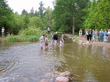 Tourists Wade The Mississippi Near Lake Itasca
