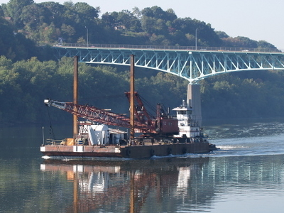 The Towboat Annette G Pushing A Dredger Crane Barge
