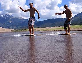Two Skimboarders On Medano Creek.