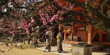 Two Women Praying In Front Of The Chishusha