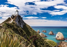 View Nugget Point Lighthouse - Otago NZ