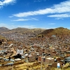 View Puno City Spread Along Lake Puno Shoreline In Peru