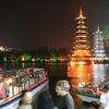 Visitors Admiring Guilin Sun & Moon Towers