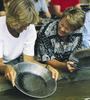 Visitors Pan For Gold At El Dorado Gold Mine