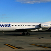 A Skywest Fokker 100 Parked At Melbourne Airport