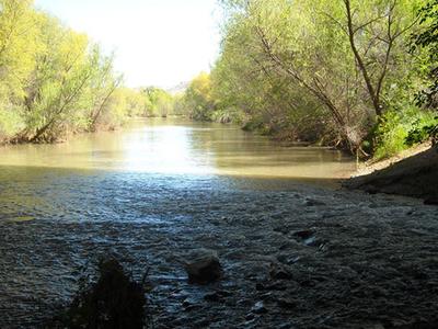 Water Flowing Beneath The White Bridge