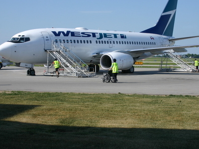 A WestJet Plane At YKF