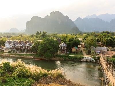 Wooden Bridge Over Song River At Vang Vieng