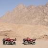 Sunset desert safari trip by quad runner