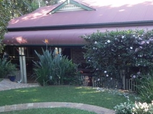 Two rooms at Camelia Cottage.