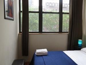 Heart of East Village Suites