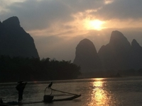 Sunset In Xingping With A Local Fishing Man