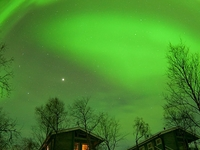 Amazing Northern Lights Over The Cottages